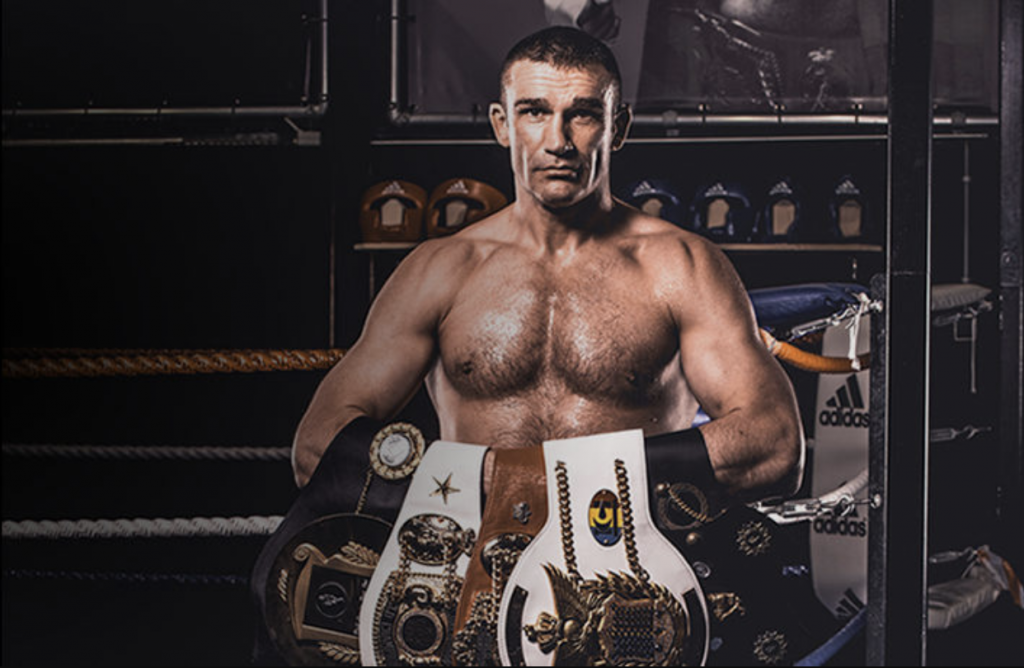 Peter Aerts holding his championship belts.