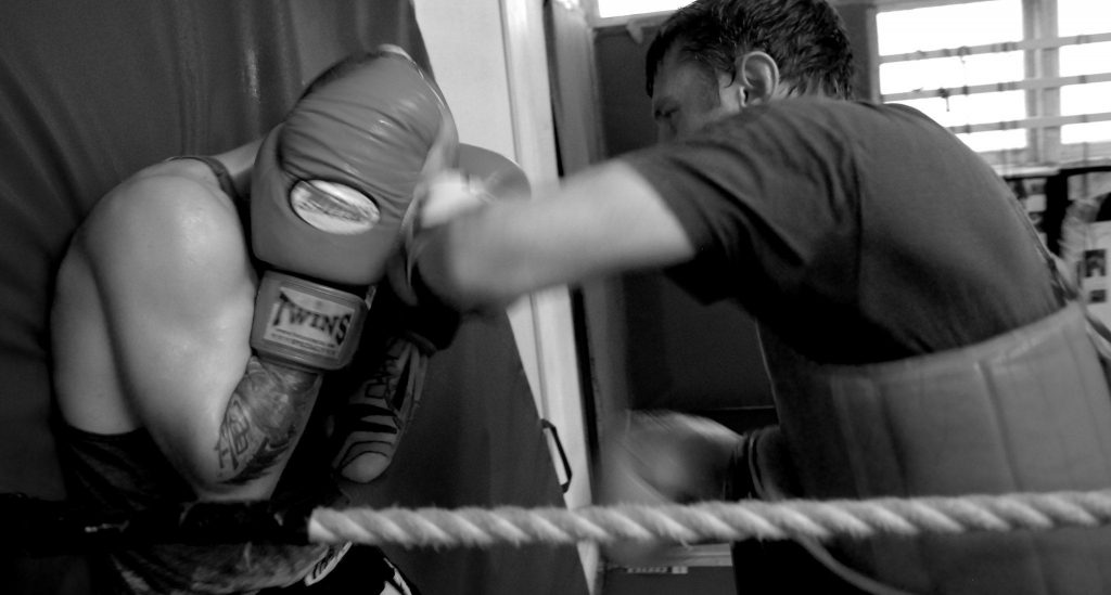 Kickboxers sparring in the fighting ring.