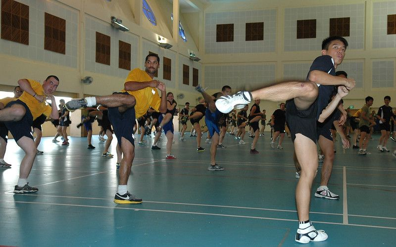 Cardio Kickboxing class with participants wearing shoes